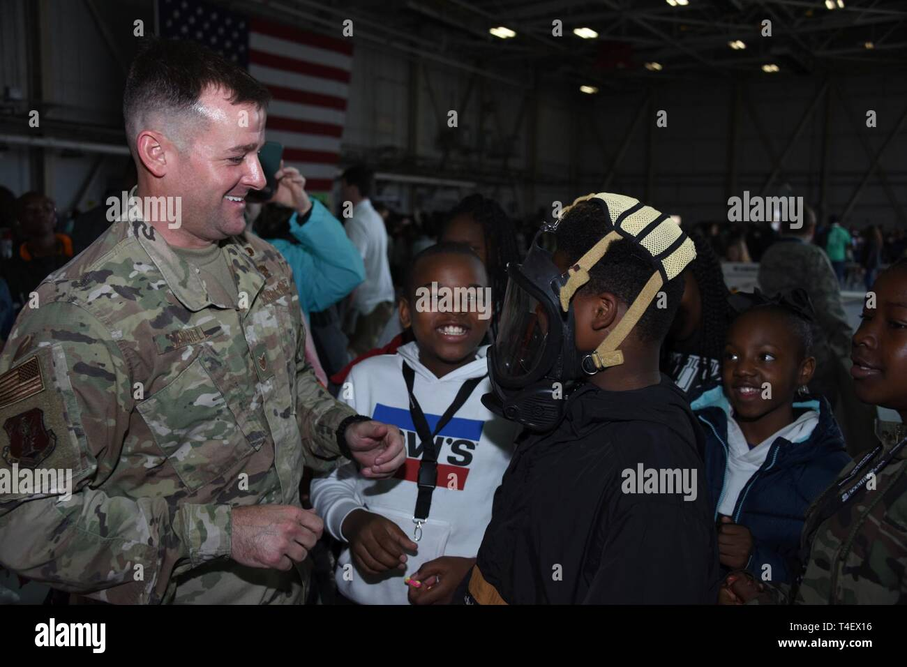 More than 2,000 students and teachers from South Carolina participate in Science, Technology, Engineering and Mathematics events during McEntire STEM Day, hosted by the South Carolina National Guard at McEntire Joint National Guard Base, April 5, 2019. U.S. Air Force Staff Sgt. Robert Campbell, assigned to the 169th Civil Engineer Squadron's Emergency Management section, explains the use and purpose for using portable breathing aparatus. STEM Day provides an up-close opportunity to work with Swamp Fox Airmen to perform hands-on learning and view the inner workings of aircraft and advanced-tech - Stock Image