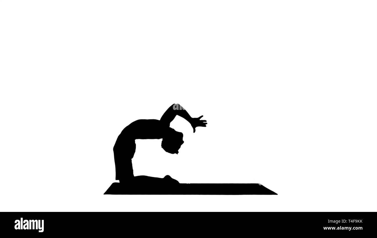 Silhouette Yogi doing camel yoga pose. - Stock Image