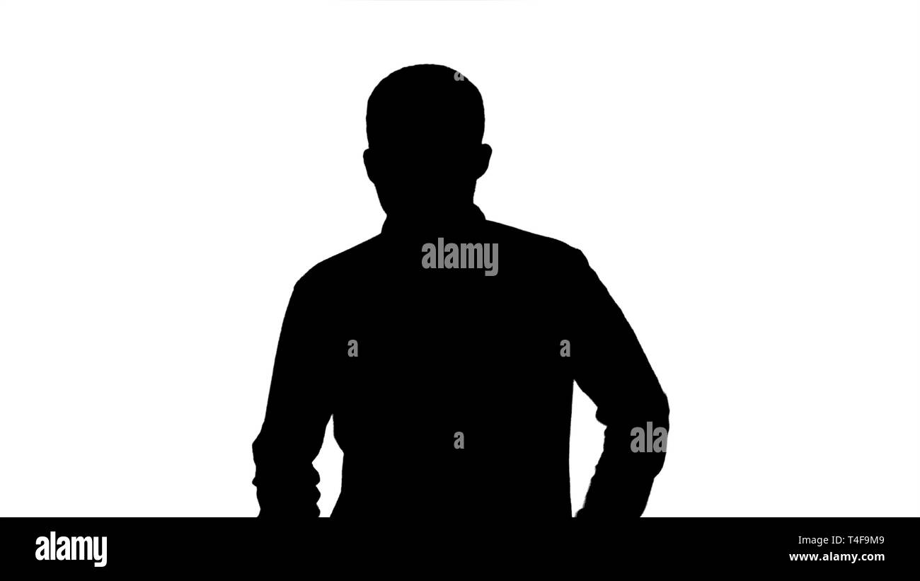 Silhouette Young man running and smiling. - Stock Image