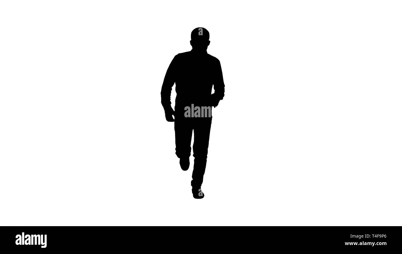 Silhouette Man starting to run in casual clothes. - Stock Image