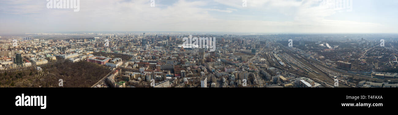 Panoramic aerial view from drone. on the city of Kiev with a railway and a stadium in the distance against the sky. - Stock Image