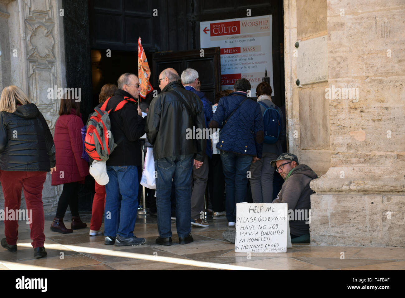Beggar outside Valencia cathedral, Spain 2019 - Stock Image