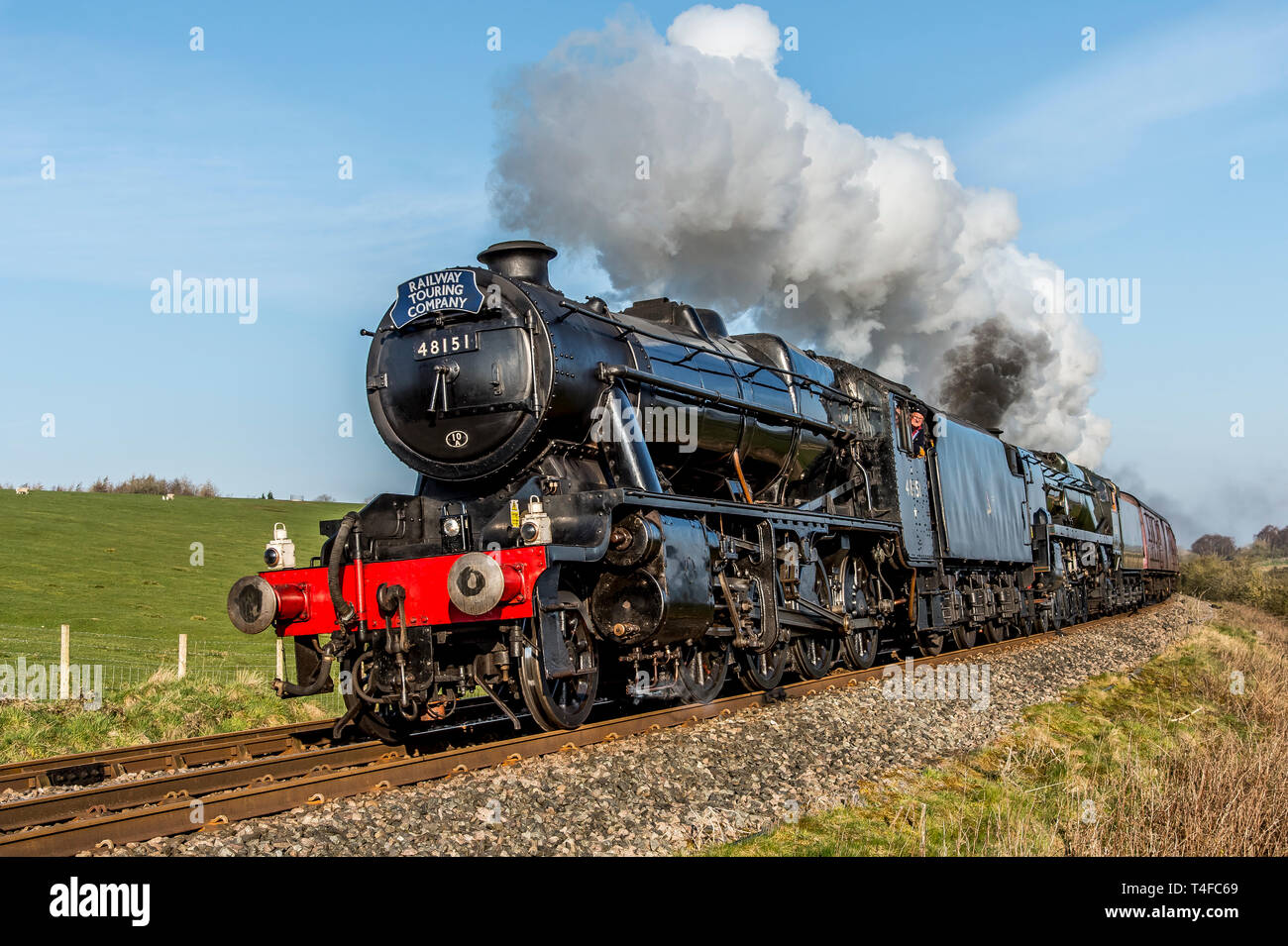 Double header steam train headed by a Black 5 48151 and the British India Line 35018 trailing after passing through Clapham in the Yorkshire Dales - Stock Image