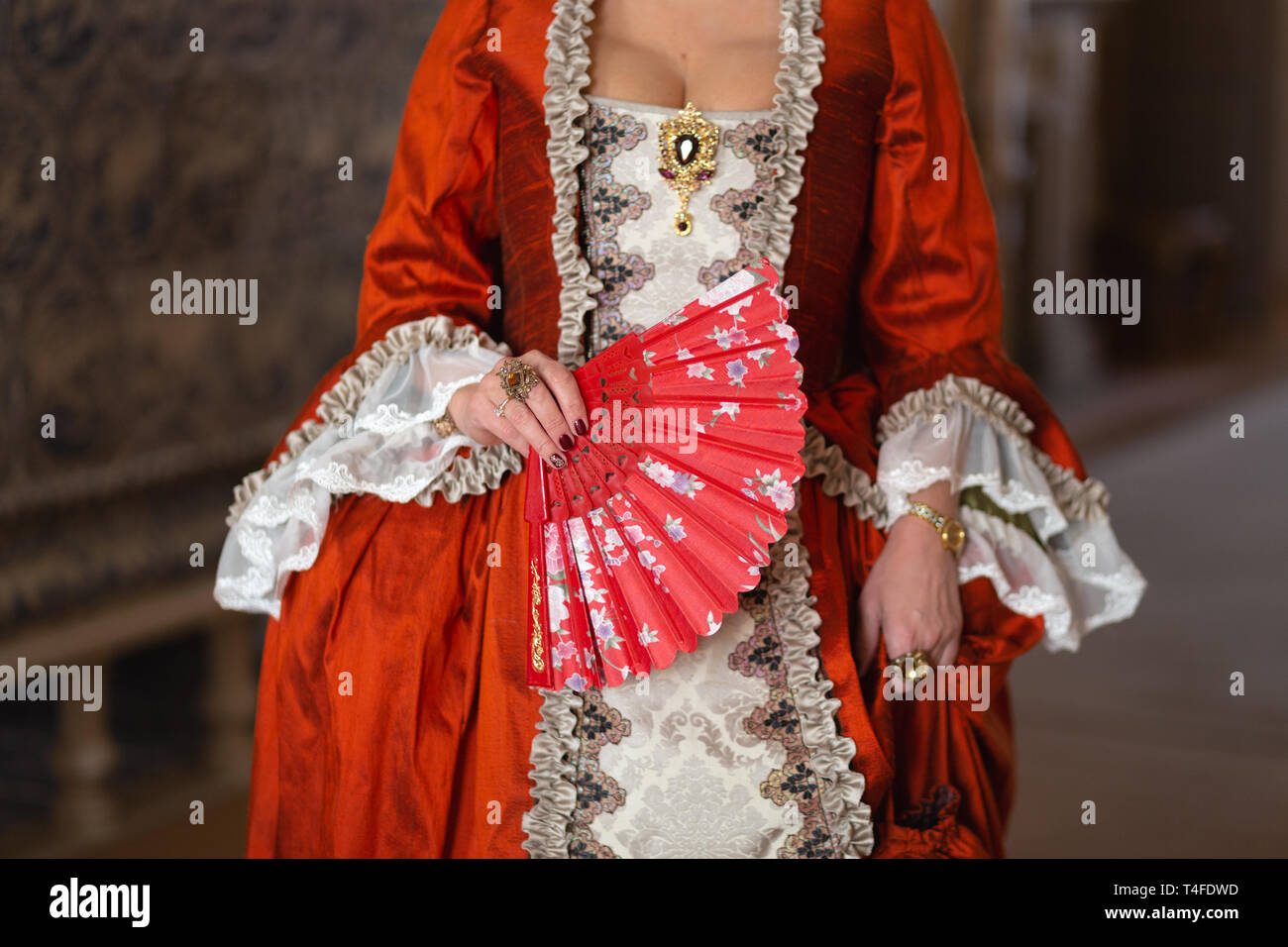 Retro style royal medieval ball - Majestic palace with gorgeous people dressed in king and queen's friends dresses with accessories such as fan and Stock Photo