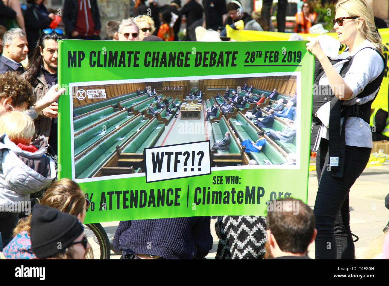 CLIMATE CHANGE DEBATE SIGN DEPICTING HOW FEW MEMBERS OF PARLIAMENT ATTENDED THE CLIMATE CHANGE DEBATE IN THE HOUSE OF COMMONS ON THE 28TH FEBRUARY 2019. EXTINCTION REBELLION DEMONSTRATION ON 15TH APRIL 2019 IN PARLIAMENT SQUARE, WESTMINSTER, LONDON, UK. Stock Photo