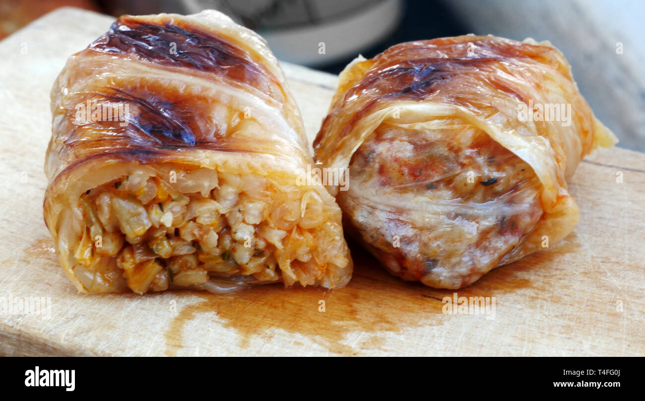 Home made food. Roasted  sarmi. Traditional meals with rice-stuffed cabbage leaves for Christmas Eve. Stock Photo