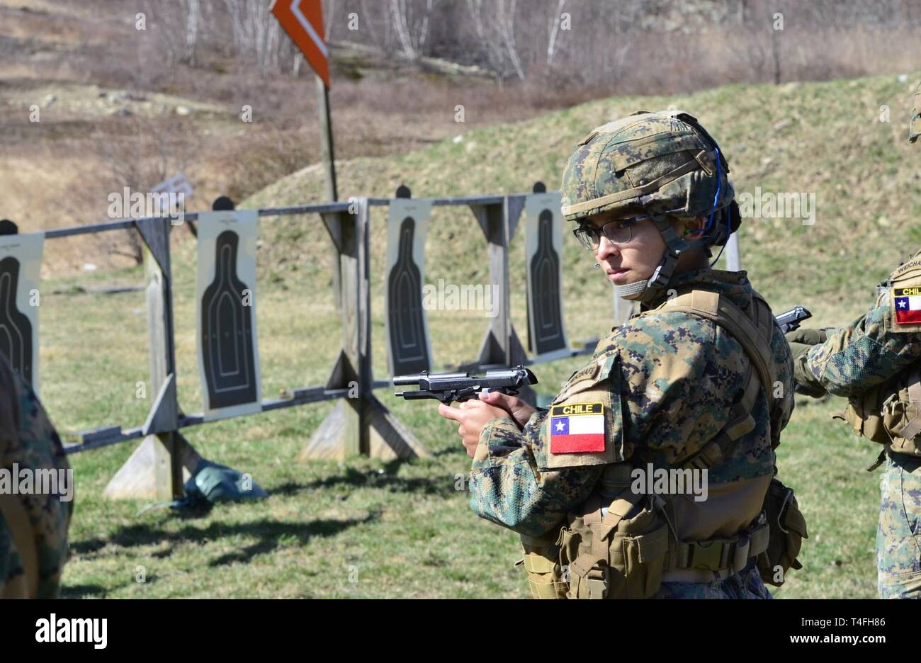 A Chilean cadet from the Bernardo O'Higgins Military School, Chile, takes part in an M9 pistol range in preparation for the 51st Sandhurst Military Skills Competition in West Point, New York, April 12-13. Sandhurst, a premier international military academy competition which began in 1967, is a two-day, approximately 30-mile course filled with individual and squad-based events designed to promote military excellence of future leaders across the world. This year, 49 teams from more than a dozen countries will participate in the competition, with two first-time teams competing from Denmark and Gr Stock Photo