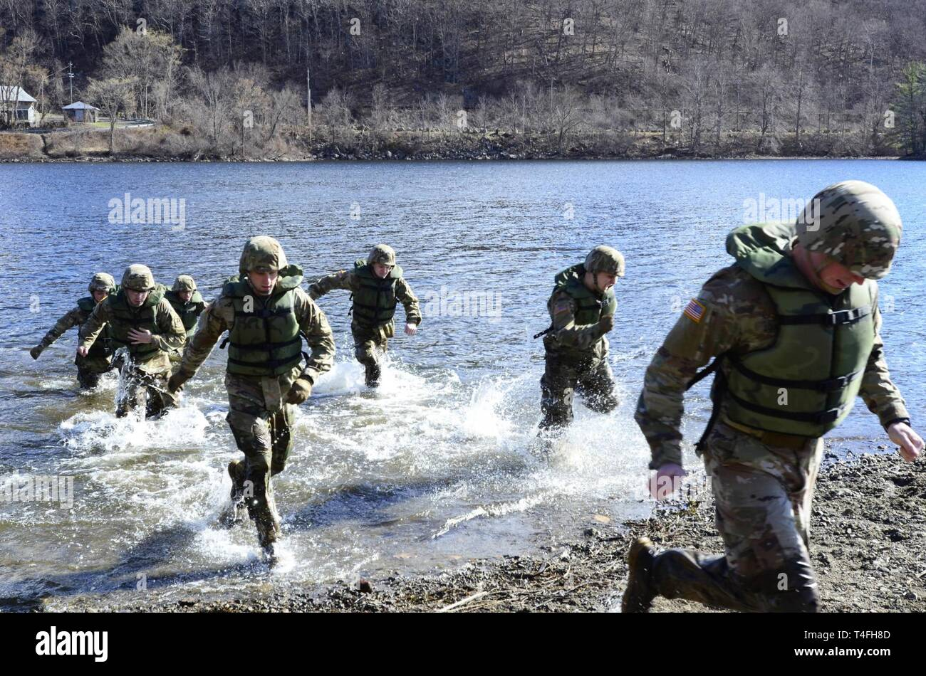 U.S. Army Reserve Officers' Training Corps Cadets from Lehigh University, Bethlehem, Pennsylvania run onto shore after testing the water depth of Stillwell Lake, West Point, New York during training in preparation for the U.S. Military Academy's 51st Sandhurst Military Skills Competition, April 12-13. Sandhurst, a premier international military academy competition which began in 1967, is a two-day, approximately 30-mile course filled with individual and squad-based events designed to promote military excellence of future leaders across the world. This year, 49 teams from more than a dozen coun Stock Photo