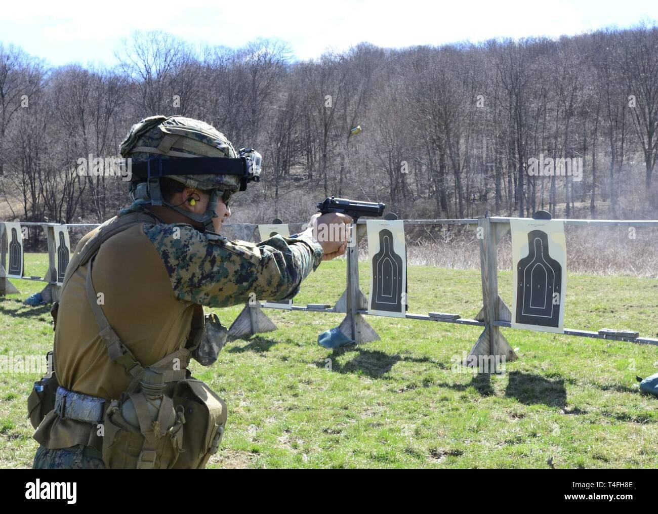 A Chilean army cadet from the Bernardo O'Higgins Military School shoots paper targets during an M9 pistol range at the U.S. Military Academy, West Point, New York, in preparation for the 51st Sandhurst Military Skills Competition, April 12-13. Sandhurst, a premier international military academy competition which began in 1967, is a two-day, approximately 30-mile course filled with individual and squad-based events designed to promote military excellence of future leaders across the world. This year, 49 teams from more than a dozen countries will participate in the competition, with two first-t Stock Photo