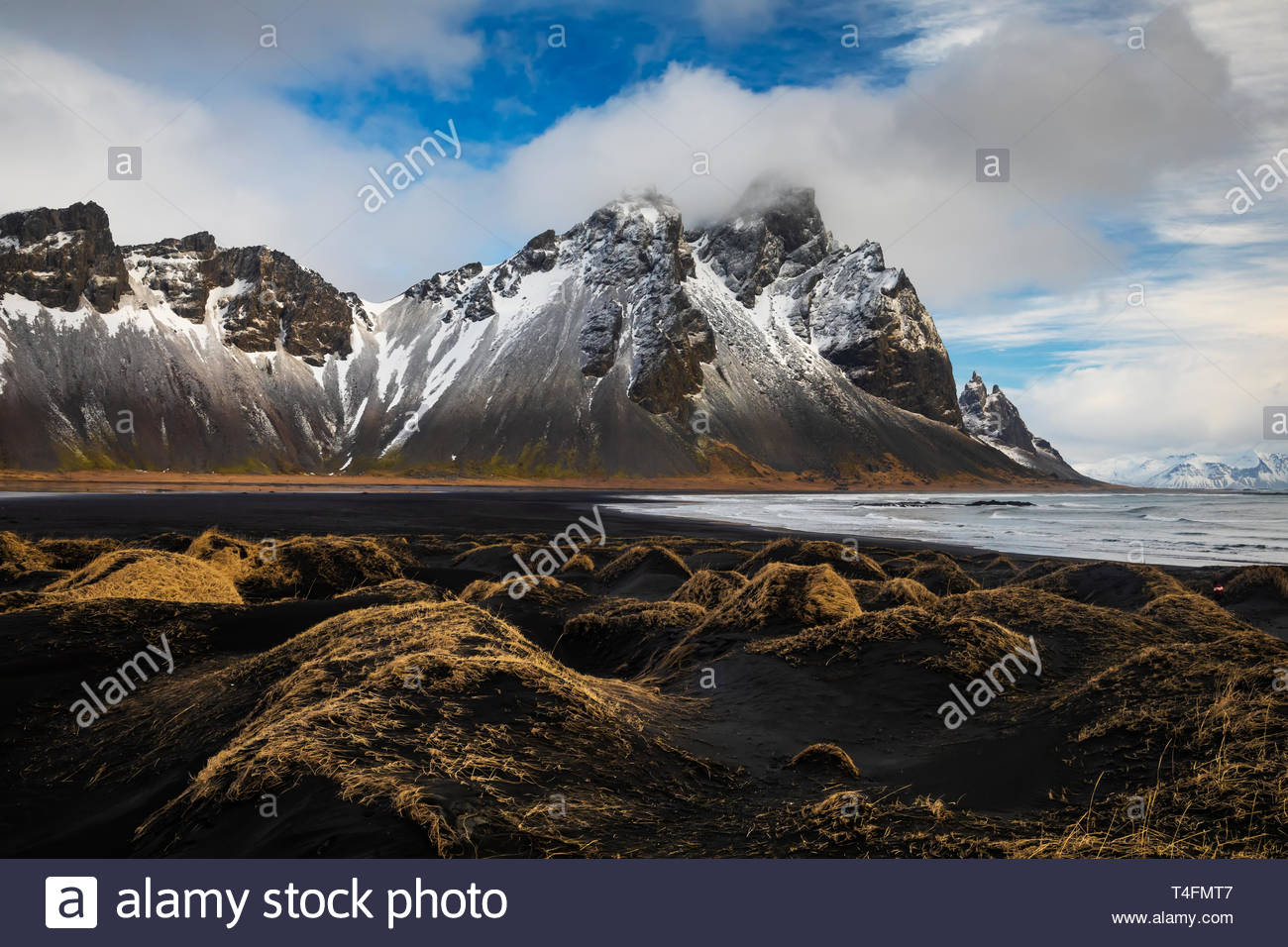 Sunset at Vestrahorn Mountain and Stokksnes beach. Vestrahorn is a popular tourist attraction along the ring road in Eastern Iceland. Stock Photo