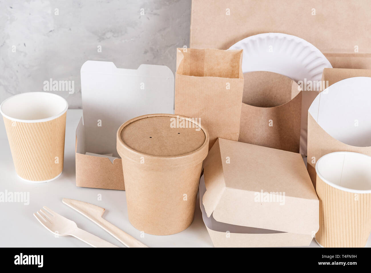 Eco Friendly Disposable Utensils Made Of Bamboo Wood And Paper On White Marble Background Draped Spoons Fork Knives Plate With Paper Cups Close U Stock Photo Alamy