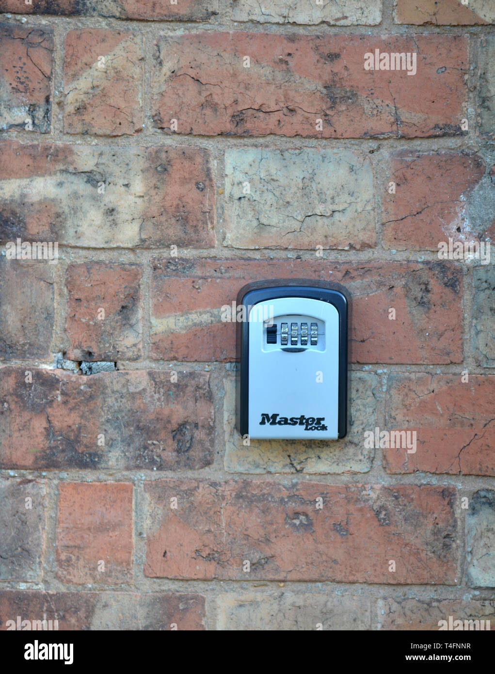 Combination secure key box on outside wall of a property on Old Town, Stratford upon Avon, Warwickshire Stock Photo