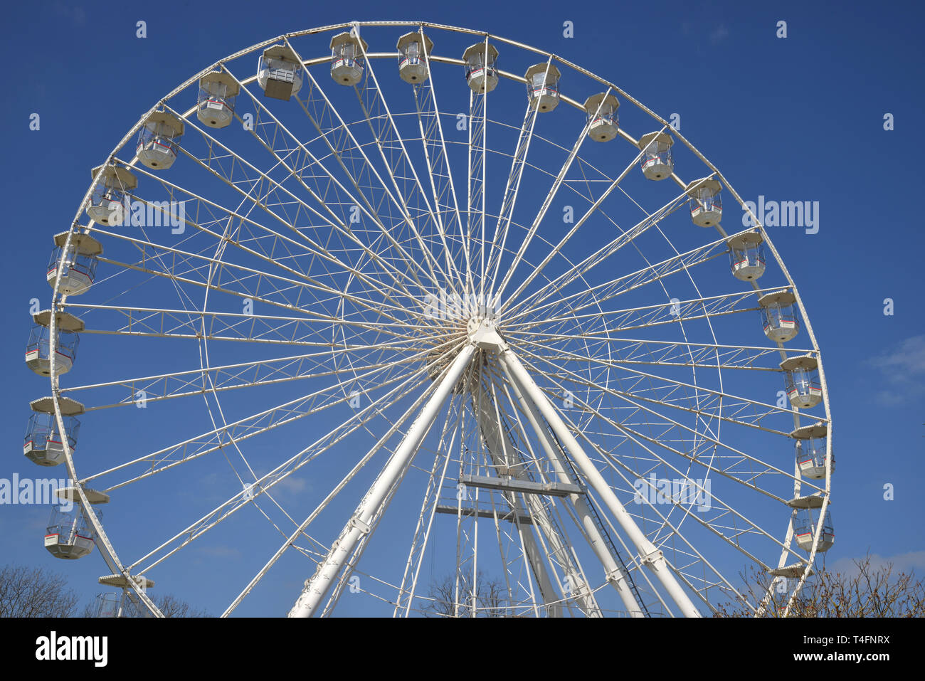 A big wheel or ferris wheel has been constructed on the bank of the River Avon, Stratford upon Avon, Warwickshire Stock Photo