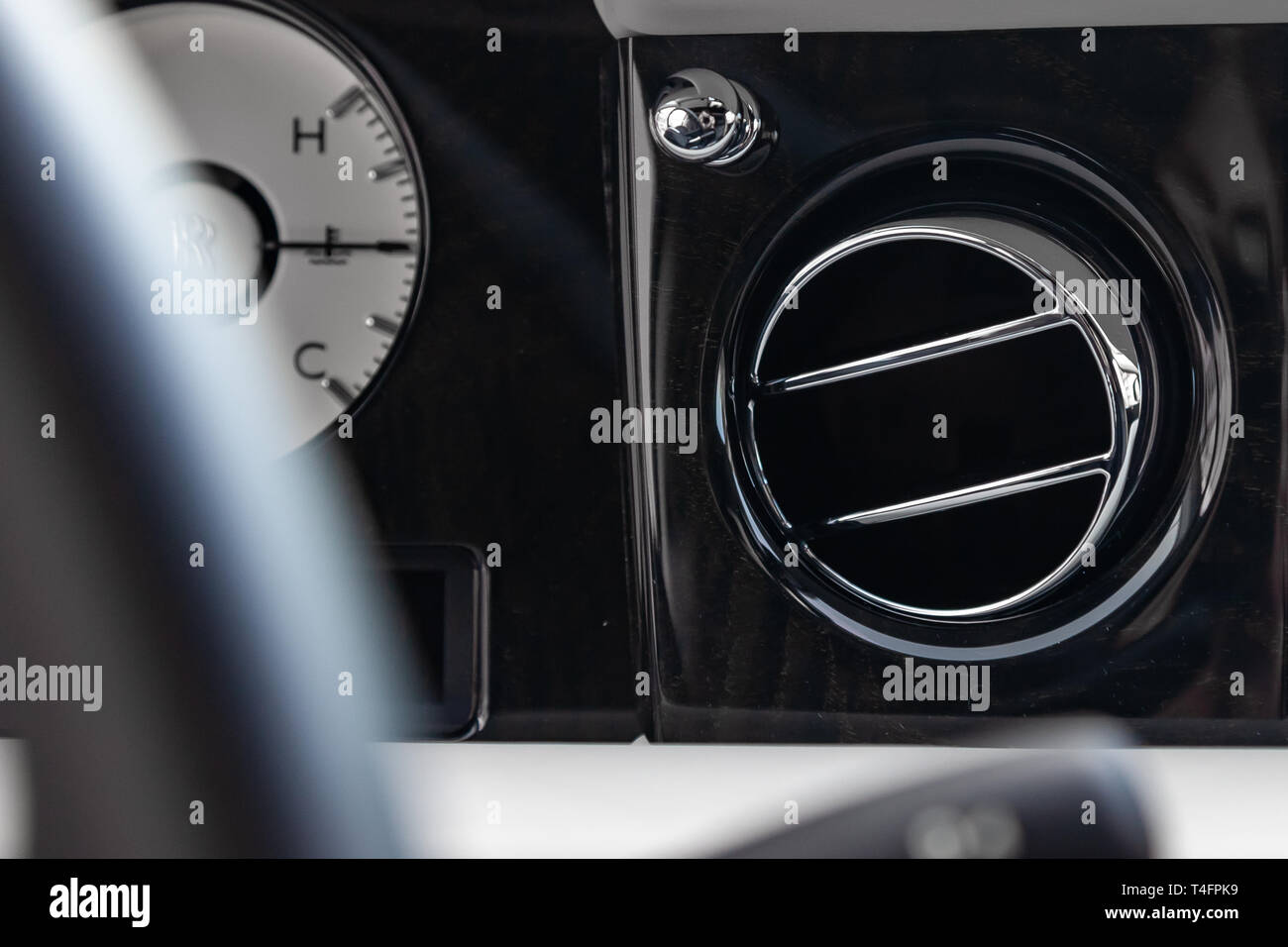 A close-up view of a part of the interior of a modern luxury car with a view of the ventilation deflector of the stove for heating and cooling the pas - Stock Image