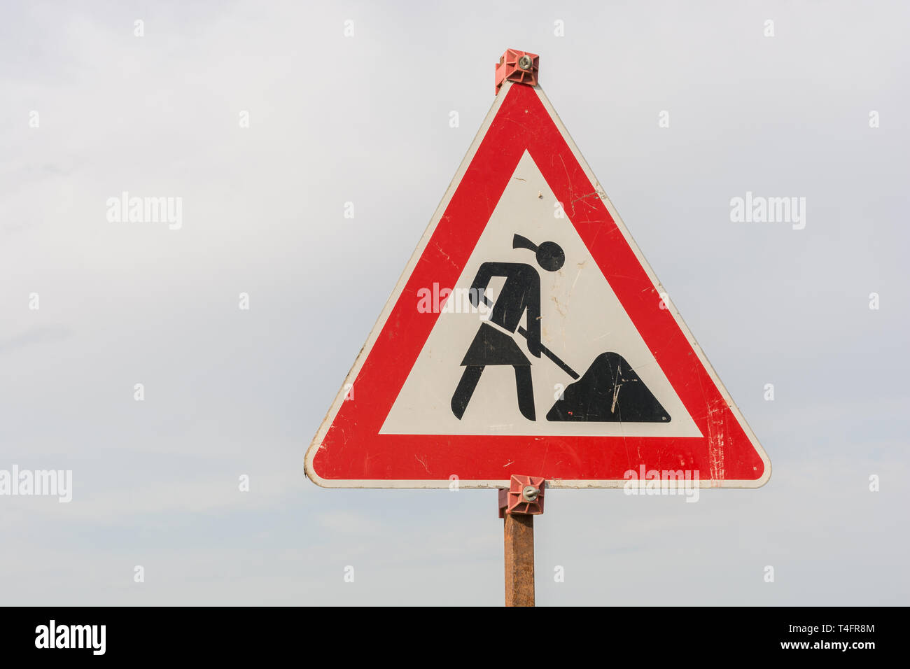 Construction site sign with a female construction worker as a symbol of feminism in professional life - Stock Image