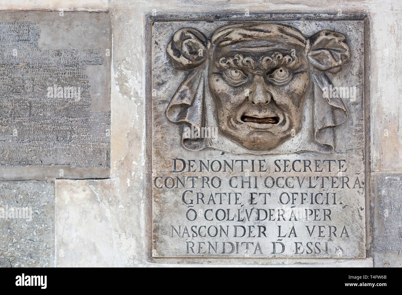 """""""Lion's mouth"""" post box for anonymous denunciations, Doge's Palace, Venice, Italy Stock Photo"""