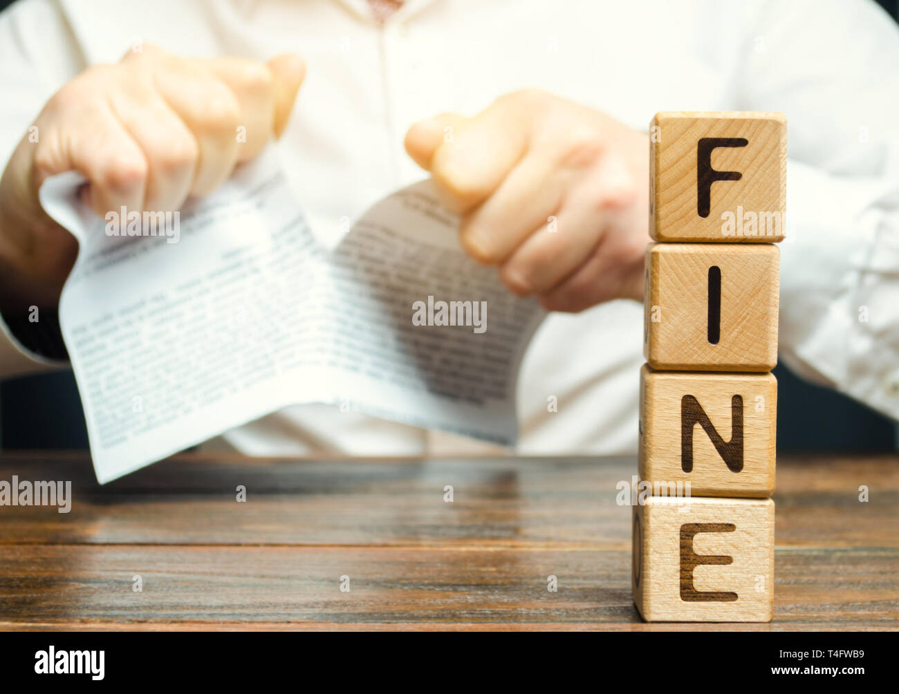 A person disputed the illegal fines and taxes. Unfair tariffs and penalties. Proof of innocence and exemption from payment. Categorical disagreement w - Stock Image