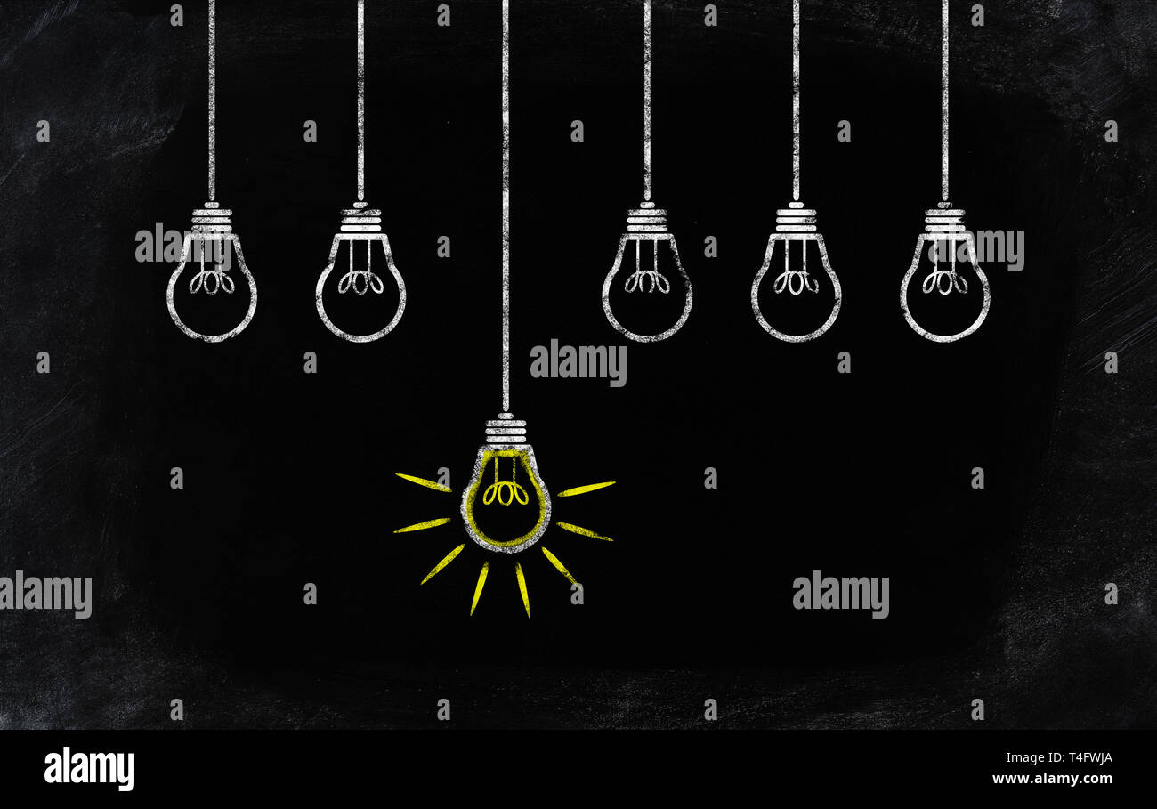 chalk drawing of one standing out glowing light bulb besides others not glowing - Stock Image