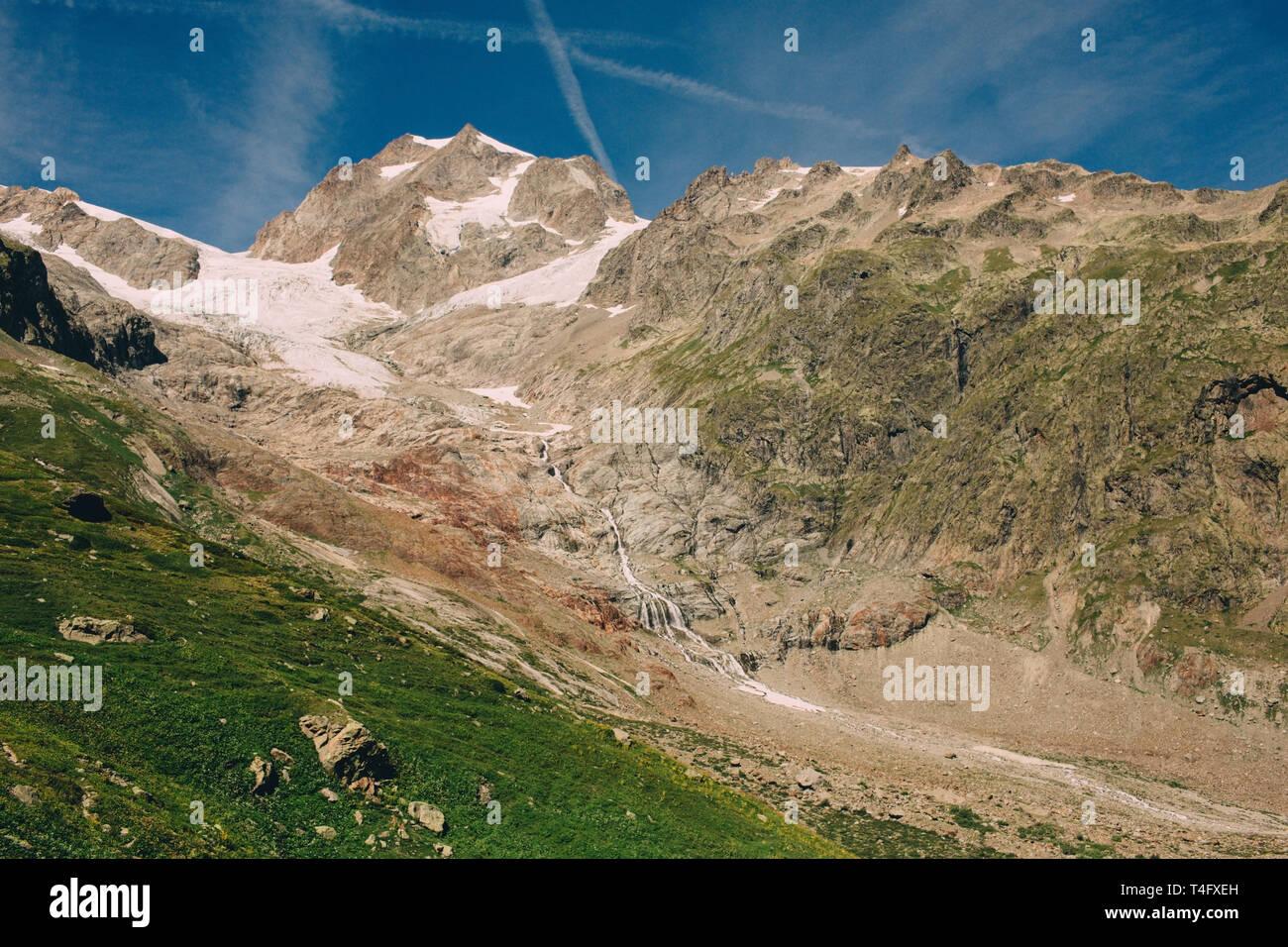 glacier on the popular hiking track around the Mont Blanc near alpine hut Elizabeth. - Stock Image