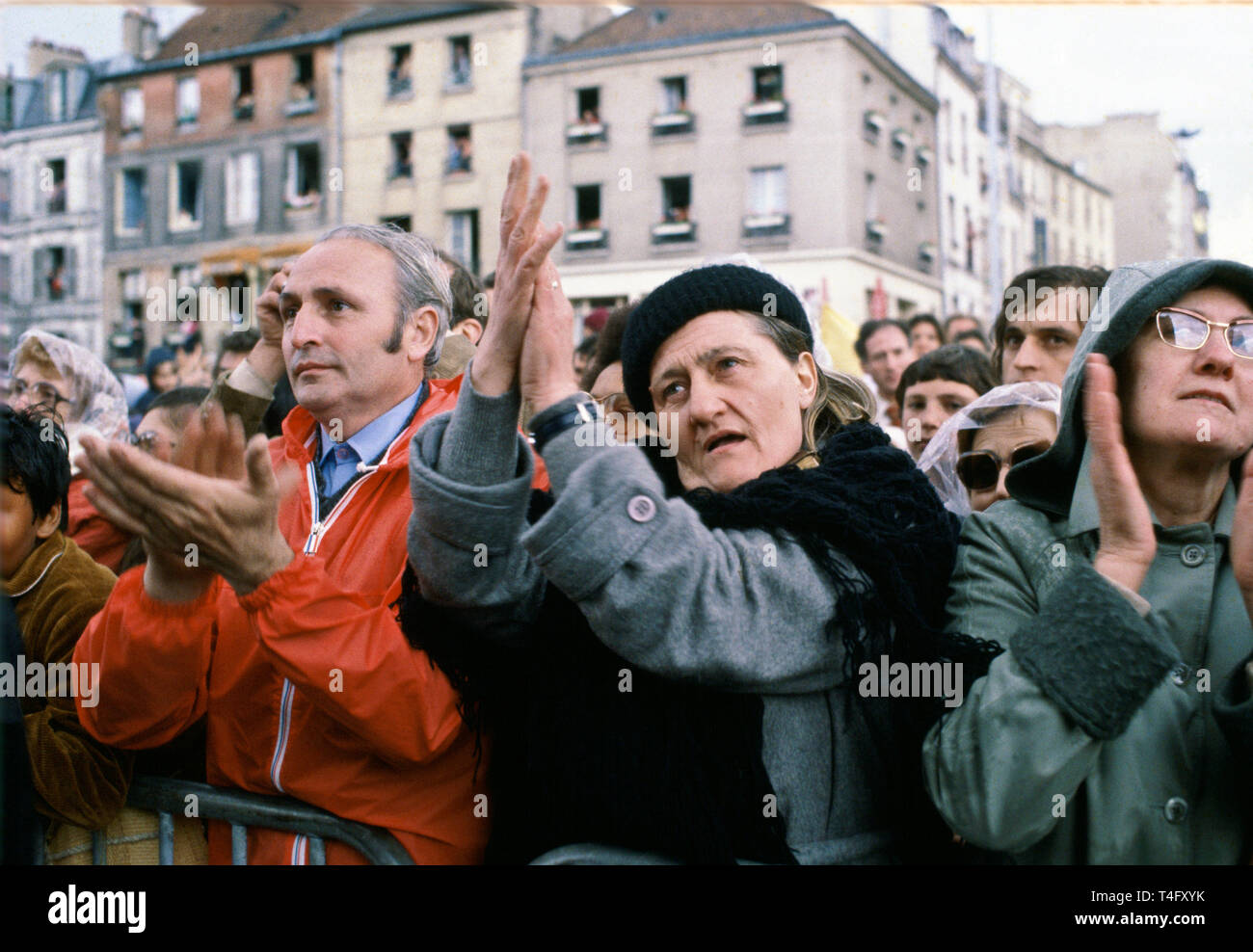 Pilgrims in crowd applaud Pope John Paul II during his visit to Paris, France Stock Photo