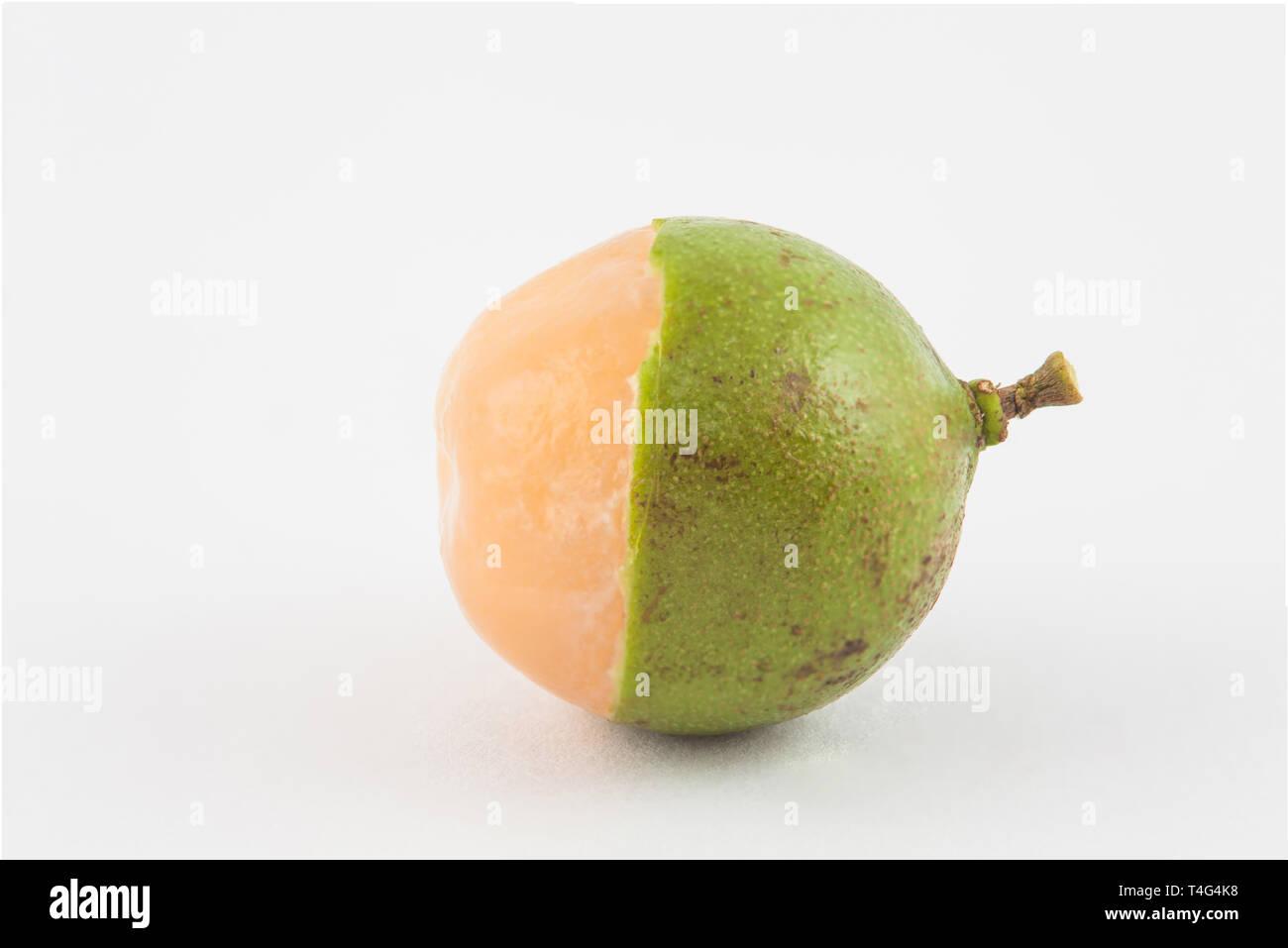Delicious exotic tropical fruit called Melicoccus bijugatus - Stock Image