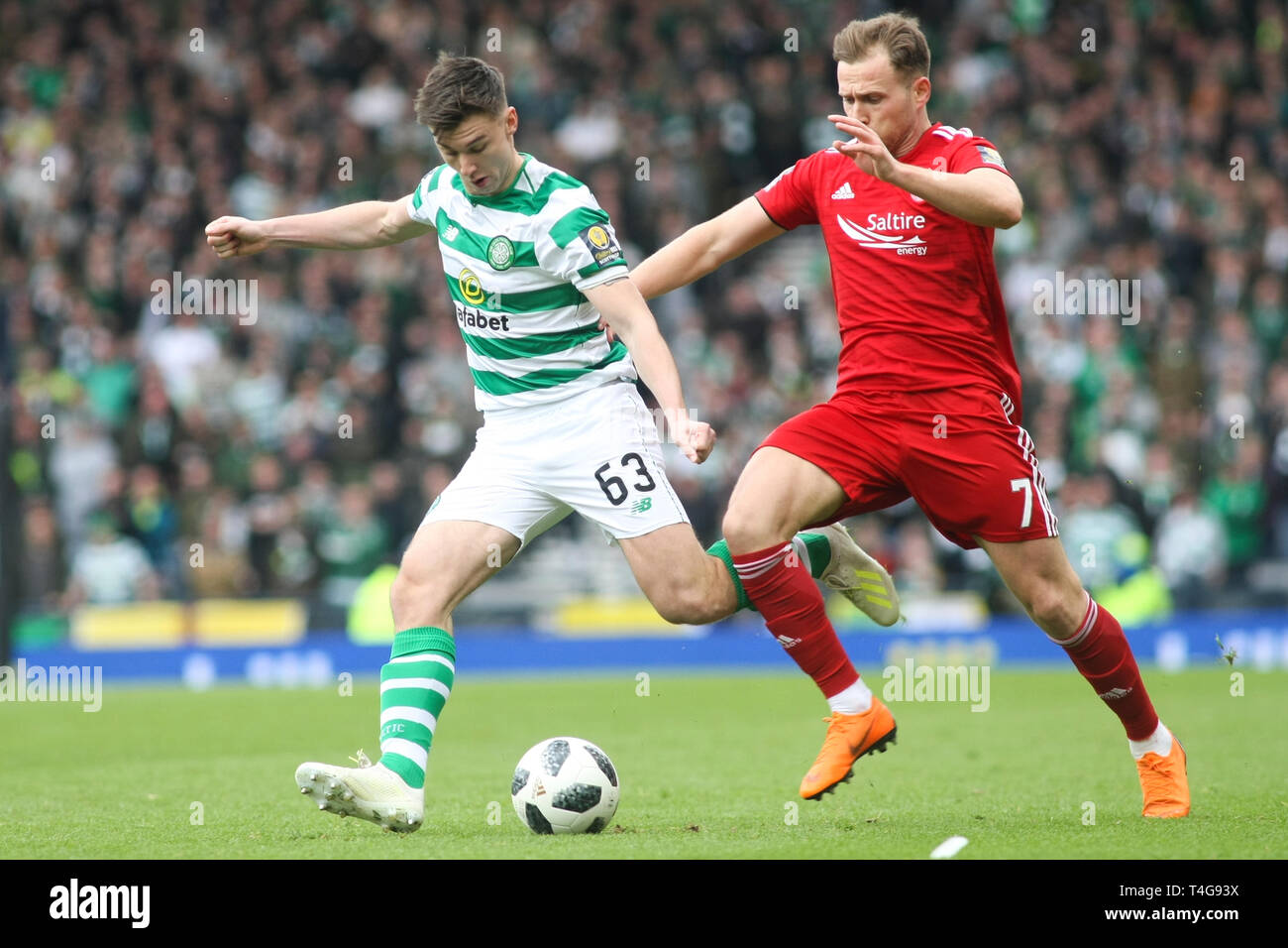 Glasgow, Scotland - April 14. Kieran Tierney of Celtic and Greg Stewart of Aberdeen compete for the ballduring the William Hill Scottish Cup - Stock Image