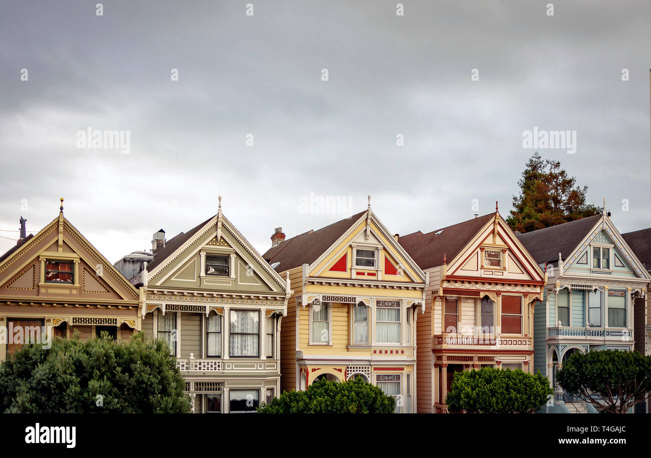 View of the famous Painted Ladies in Alamo Square in San Francisco. Victorian and Edwardian houses repainted - Stock Image