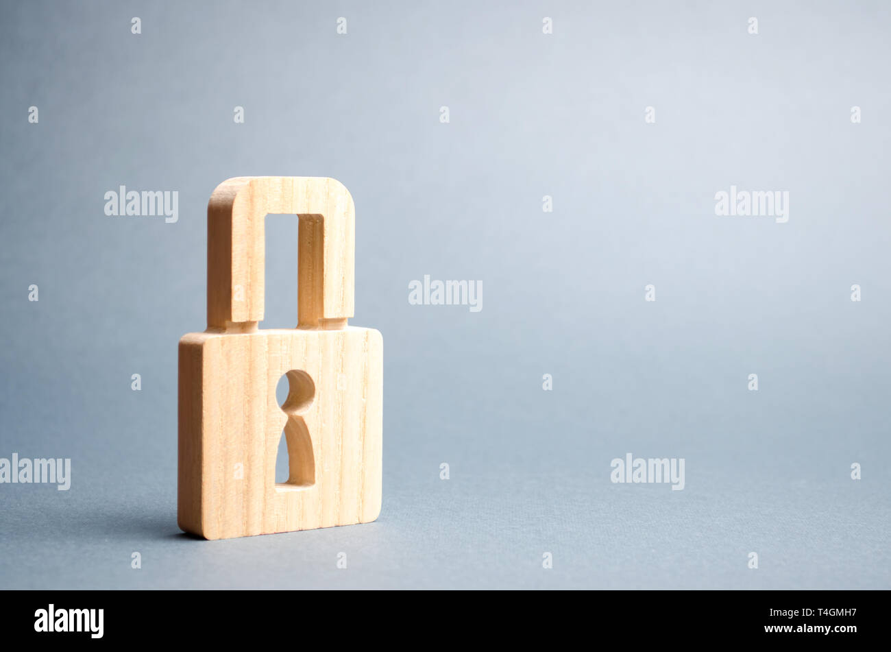 A padlock on a gray background. information safty. concept of the preservation of secrets, information and values. Protection of data and personal inf - Stock Image