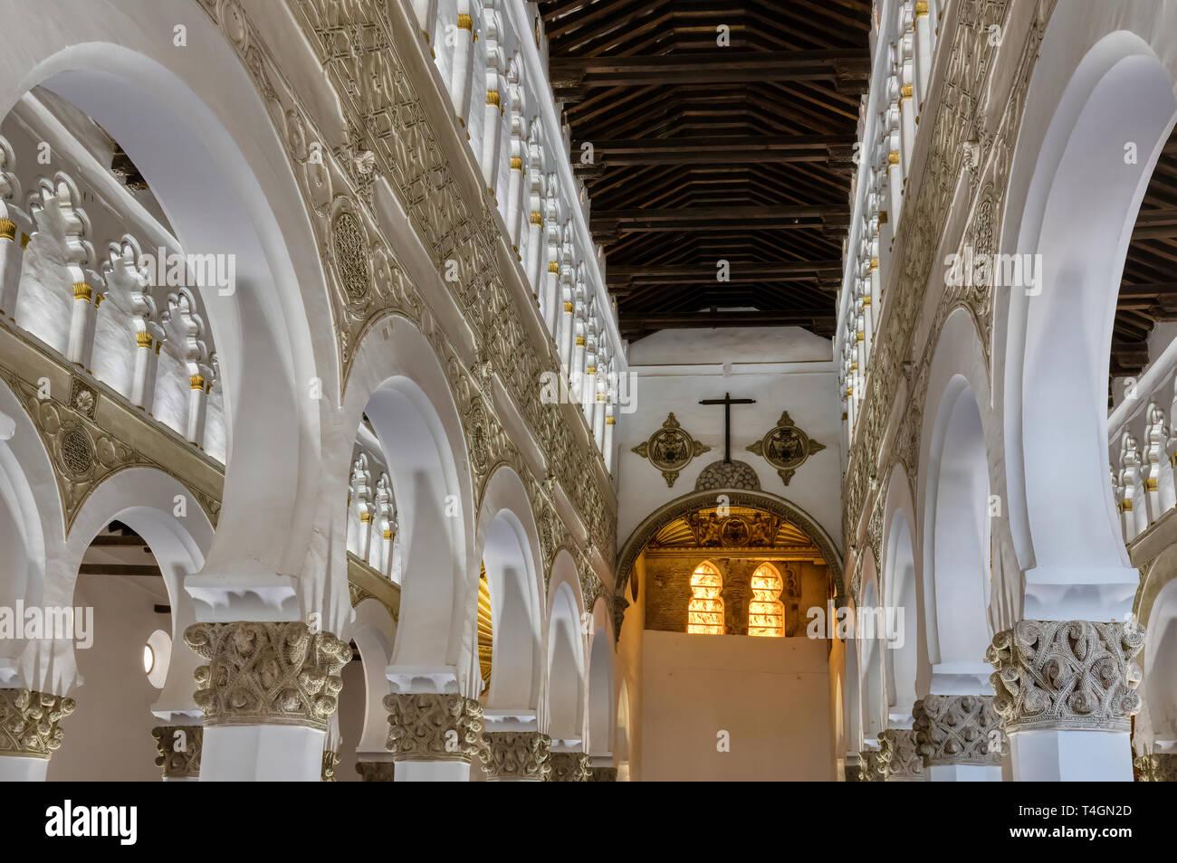 TOLEDO, SPAIN - MARCH 23,2019: White arches at Ancient Sinagoga de Santa Maria La Blanca (Synagogue) in the historical center of Toledo, Spain Stock Photo