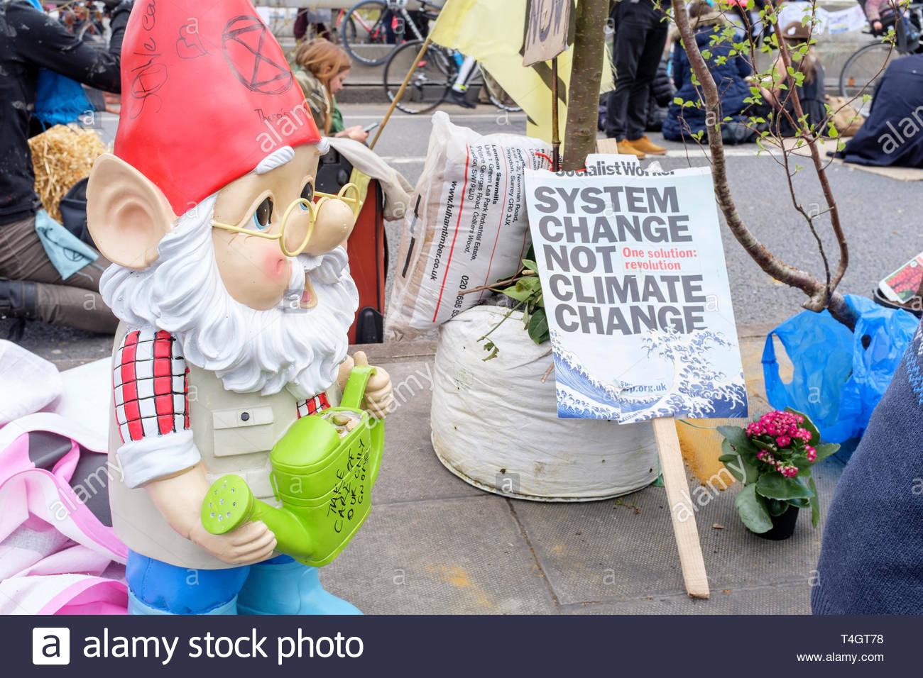 Extinction Rebellion environmental activists occupy Waterloo Bridge, London. - Stock Image