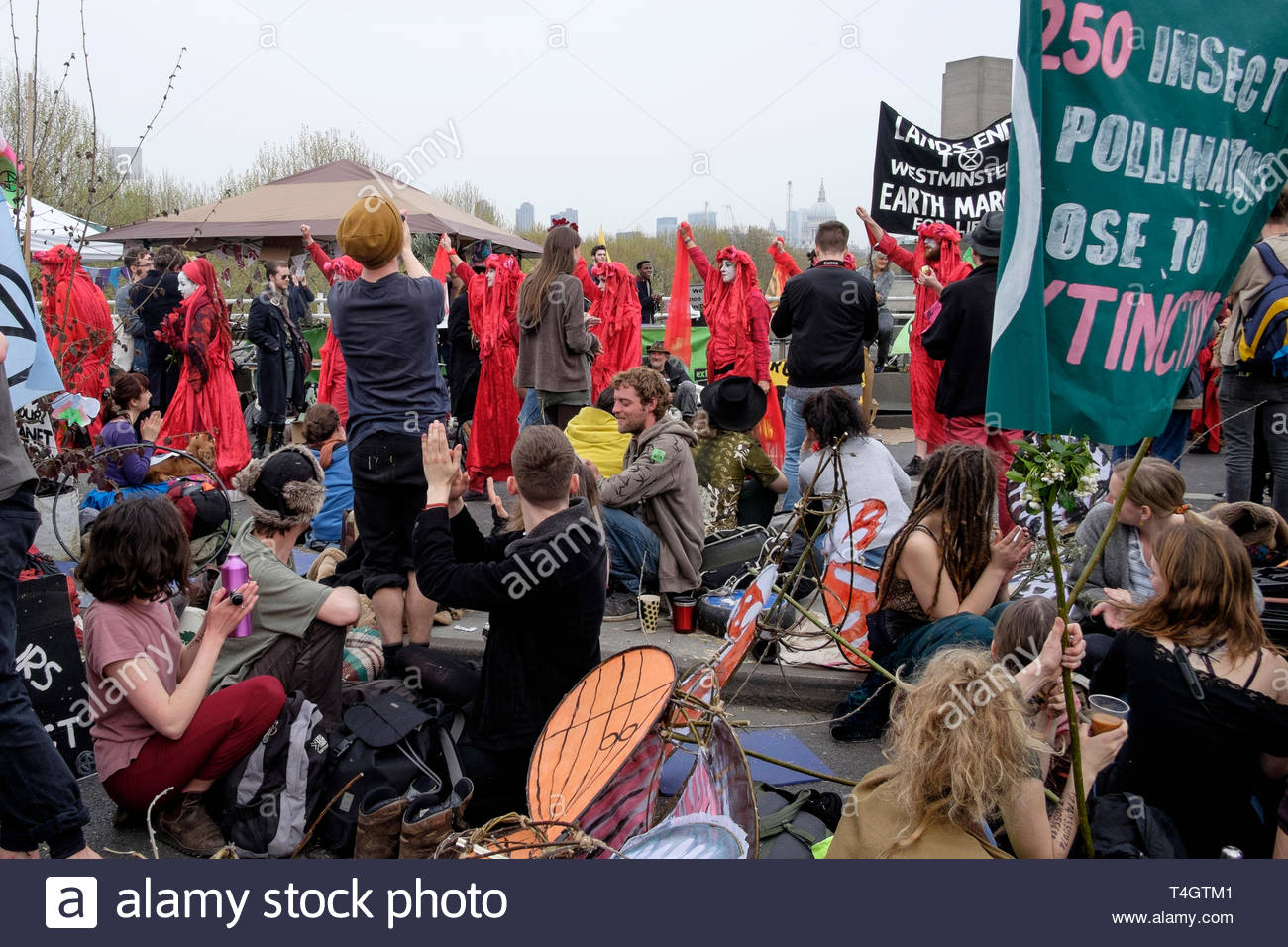 Extinction Rebellion environmental activists occupy Waterloo Bridge, London. Performance group Invisible Circus participate in the protest. - Stock Image
