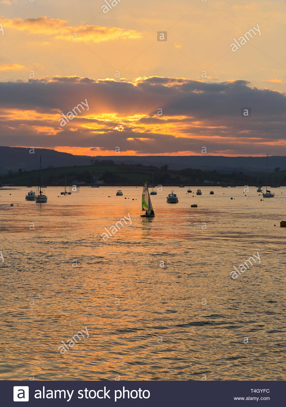 Sunset on the river exe estuary in the seaside resort of exmouth in south devon england uk - Stock Image