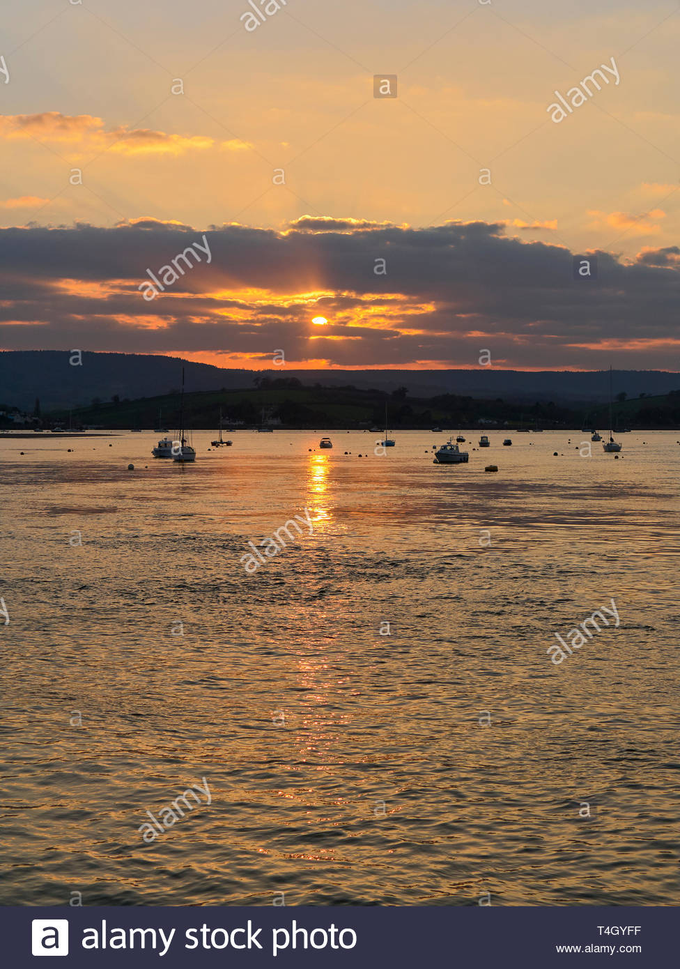 Sunset on the river exe estuary in the seaside resort of exmouth in south devon england uk Stock Photo