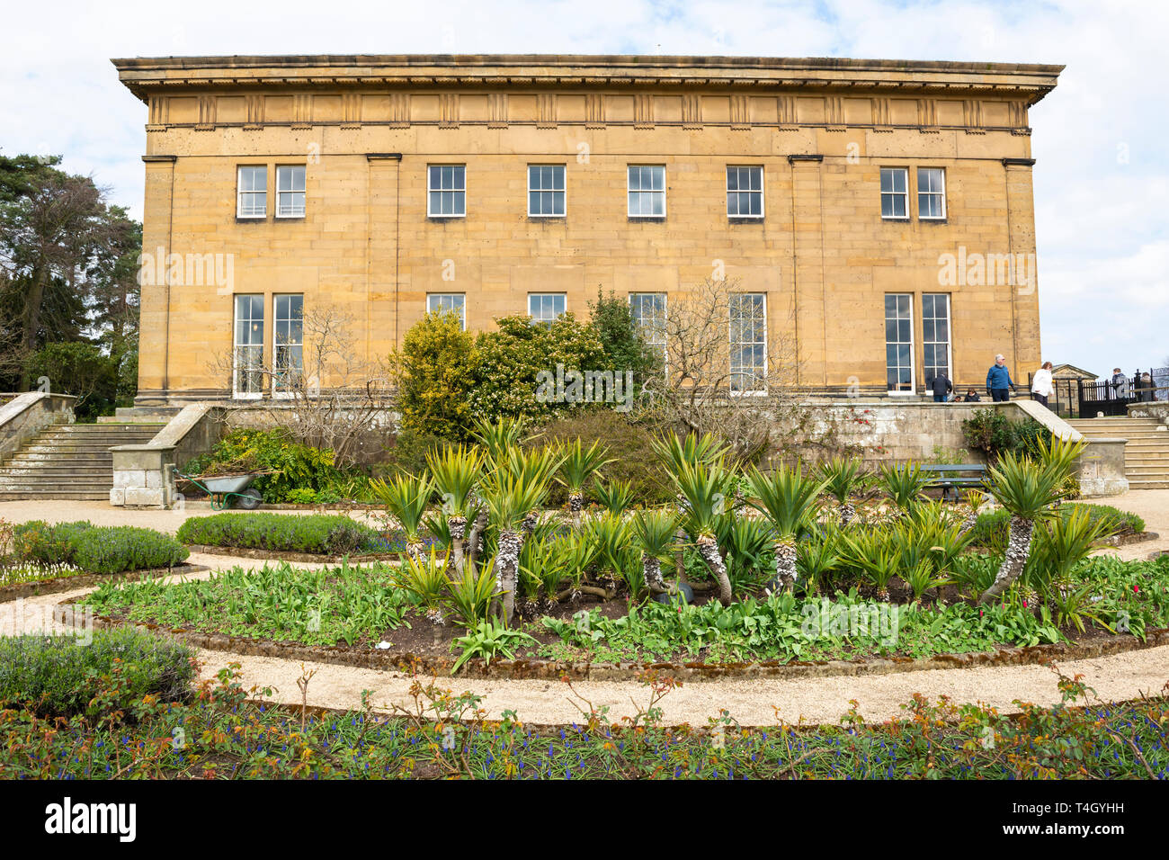 West elevation and terace garden of Belsay Hall, an early 19th Century mansion house, in Northumberland, England, UK - Stock Image