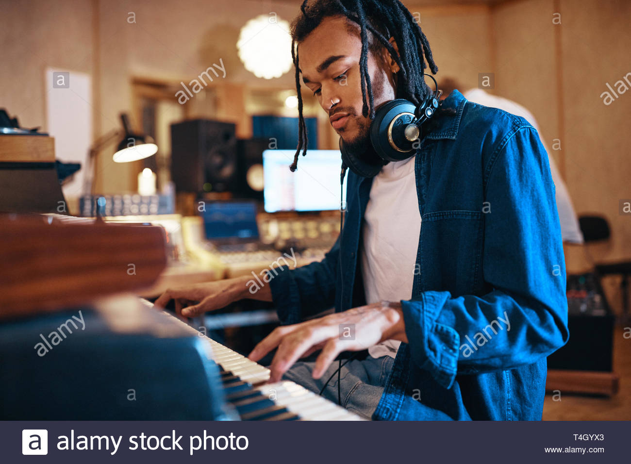 Young African American musician playing a song on the