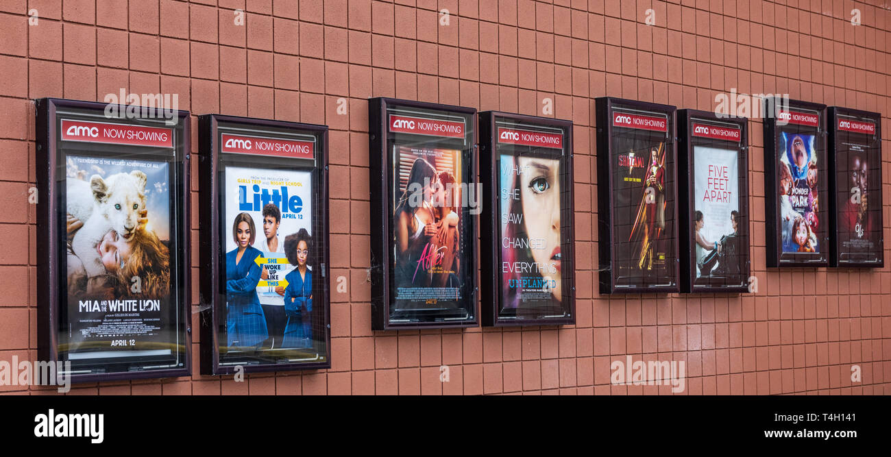 HICKORY, NC, USA-4/13/19: Posters advertising movies showing in a  local AMC movie theater. Stock Photo