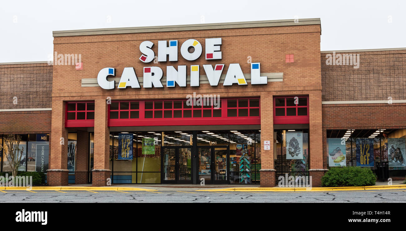 HICKORY, NC, USA-4/13/19: A Shoe Carnival storefront in a strip mall.  Shoe Carnival is an American retailer of family footwear, founded in 1978. Stock Photo
