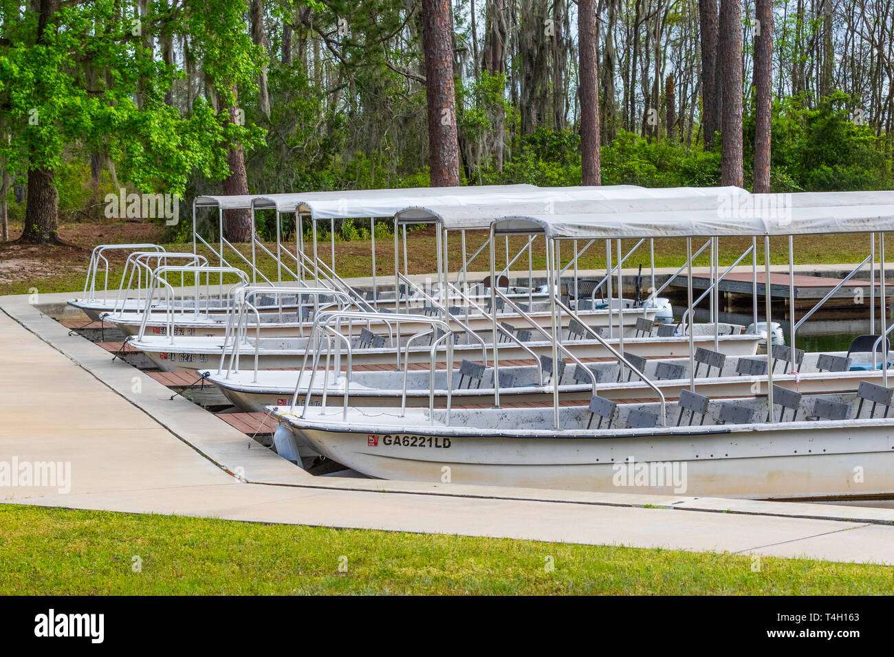 Okefenokee Swamp, Folkston, GA, USA-3/29/19: Tourist skiffs docked at the canal at eastern entrance to the swamp. Stock Photo
