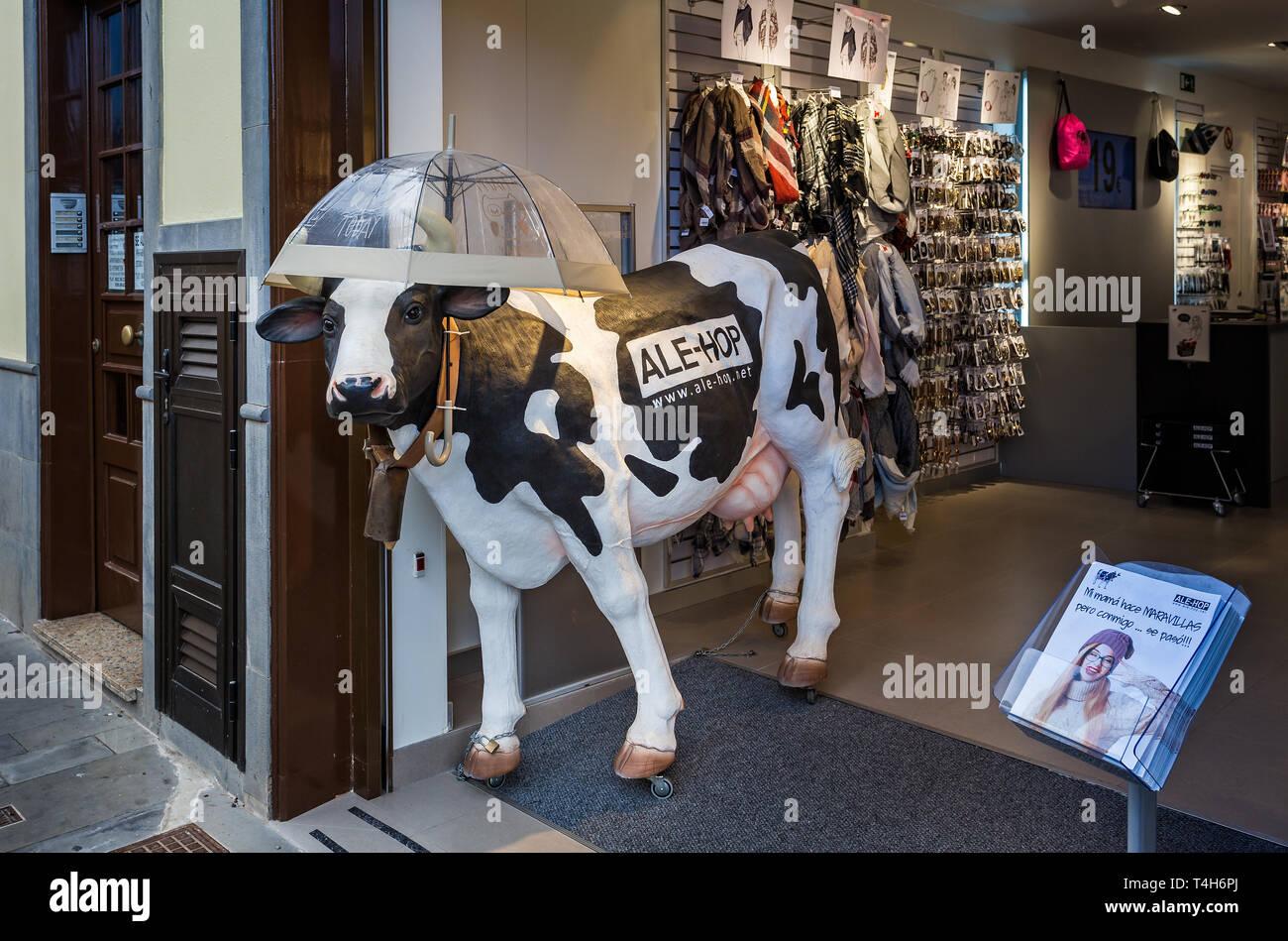 17debceda Large life size model of dairy cow with umbrella outside shop in Puerto de  la Cruz