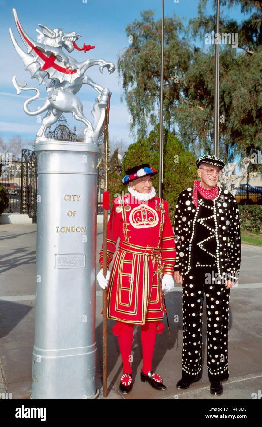 Arizona Lake Havasu City English Village Heraldic Dragon residents dress as Beefeater & Pearly King - Stock Image