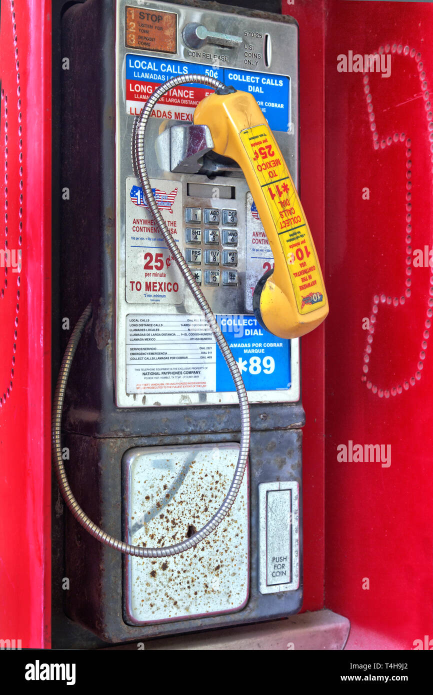 Classic Coin operated public pay telephone with receiver. - Stock Image