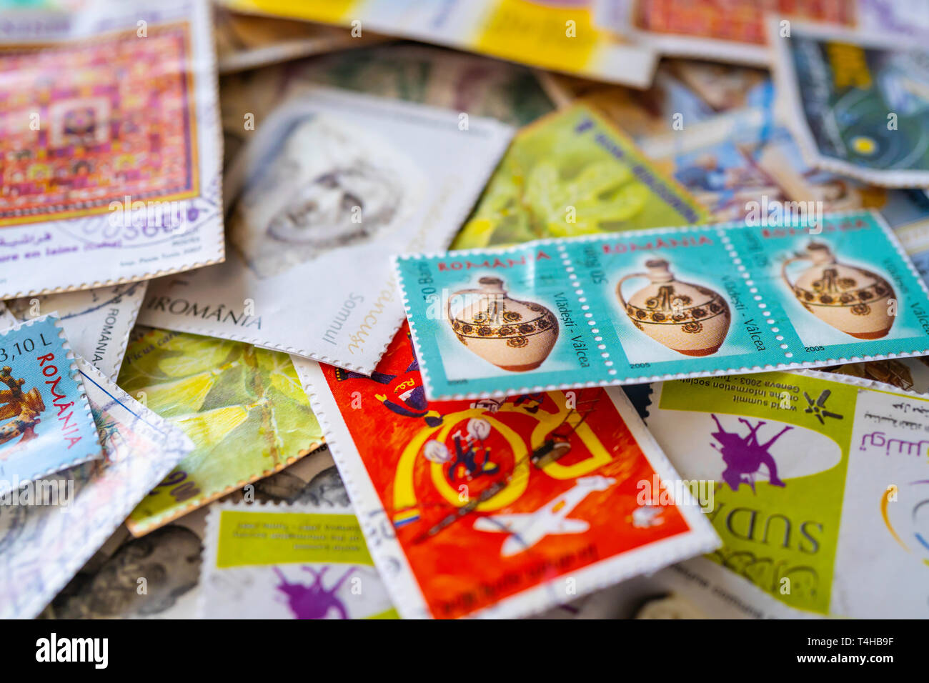 Collection of used postage stamps from around the world - Stock Image
