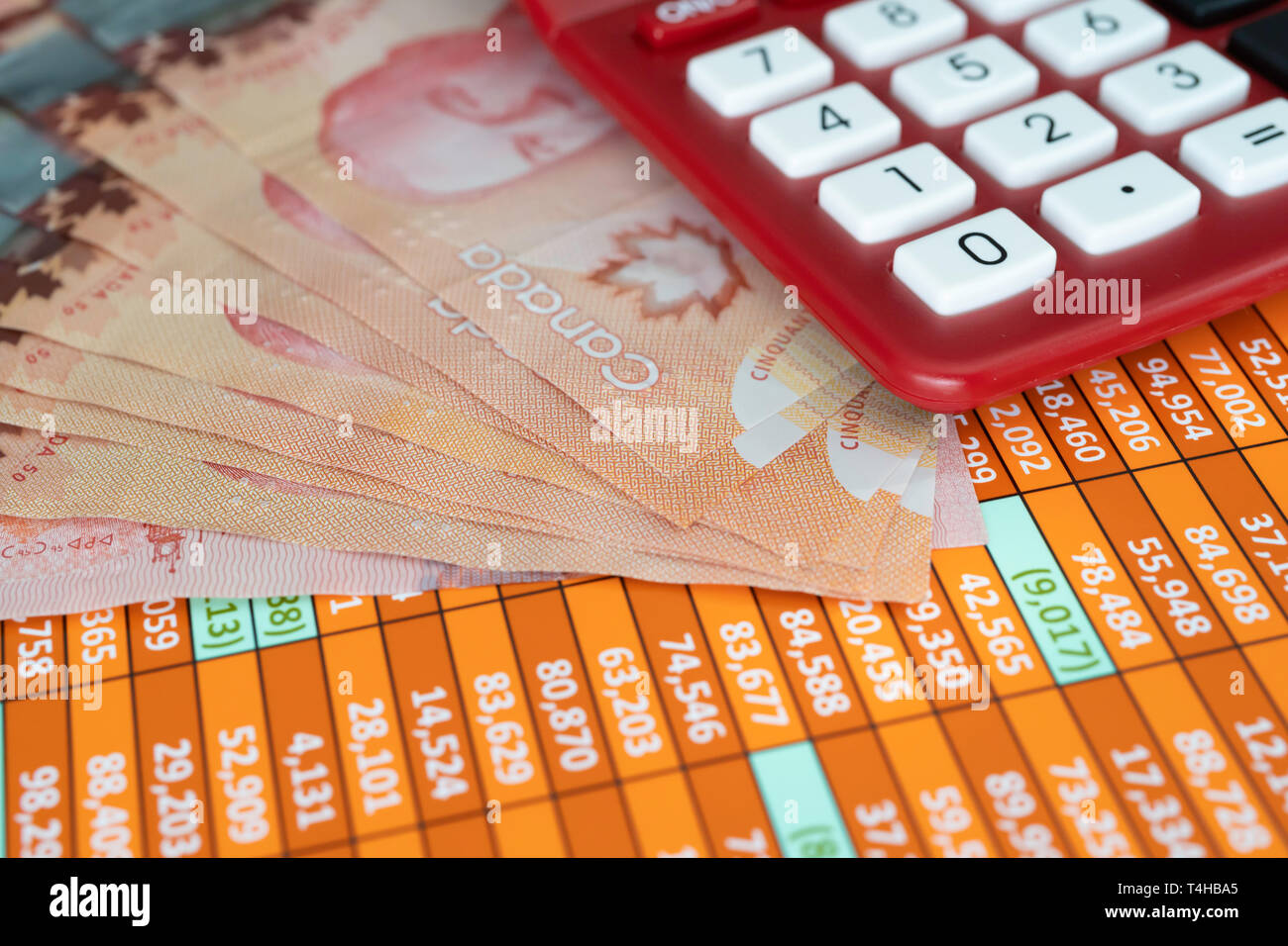 Canadian Dollar Notes on spreadsheet with Calculator - Stock Image