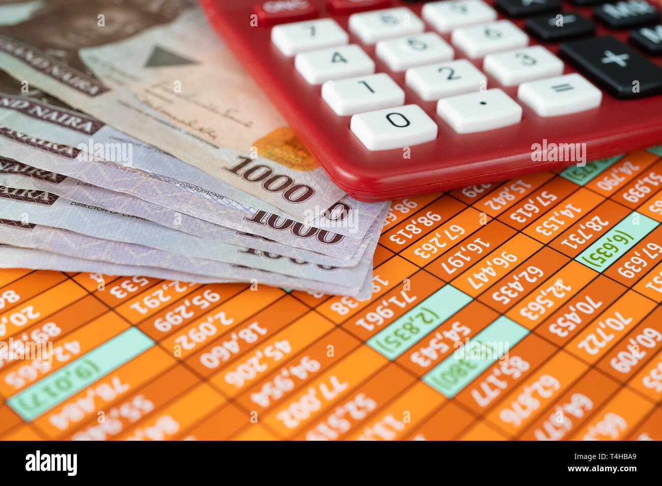 Nigerian Naira Notes with Calculator on Spreadsheet - Stock Image