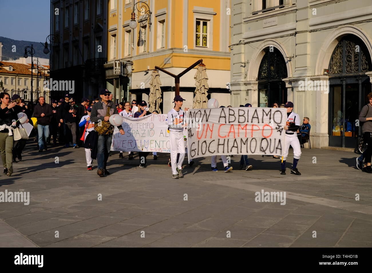 Local kids team protesting on central square that they do not have a playing field for the local baseball team, in Trieste,  Italy - April 16, 2019 Stock Photo