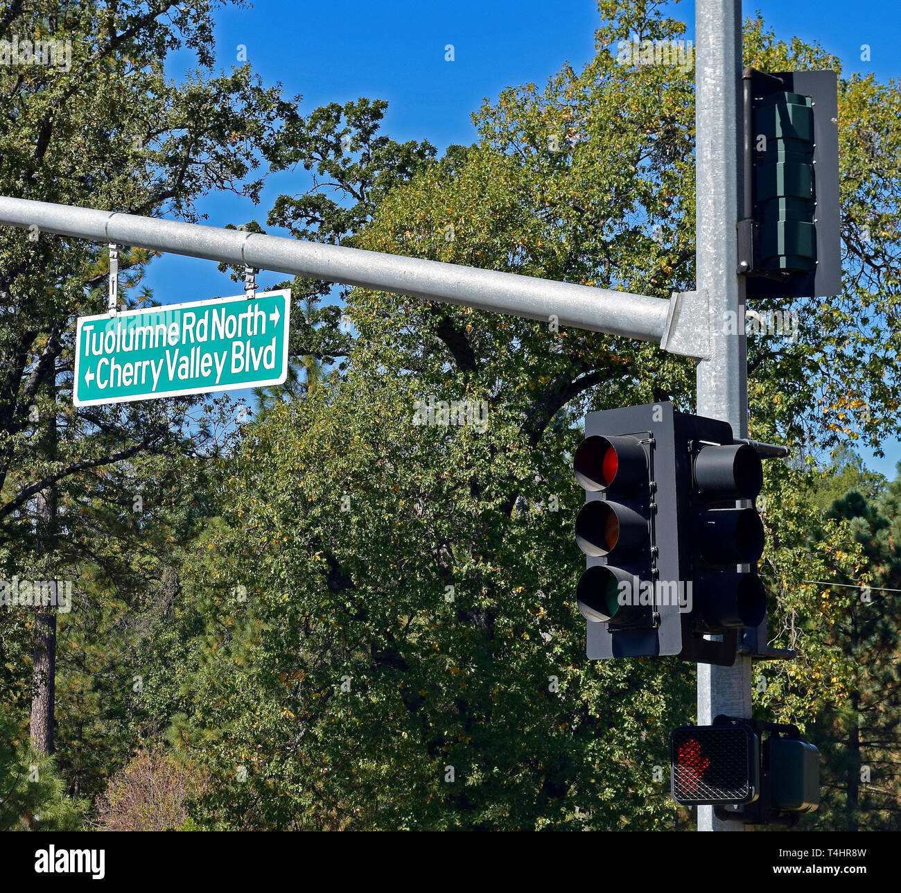 Tuolumne Rd North and Cherry Valley Blvd road signs and traffic light in Jamestown, California - Stock Image