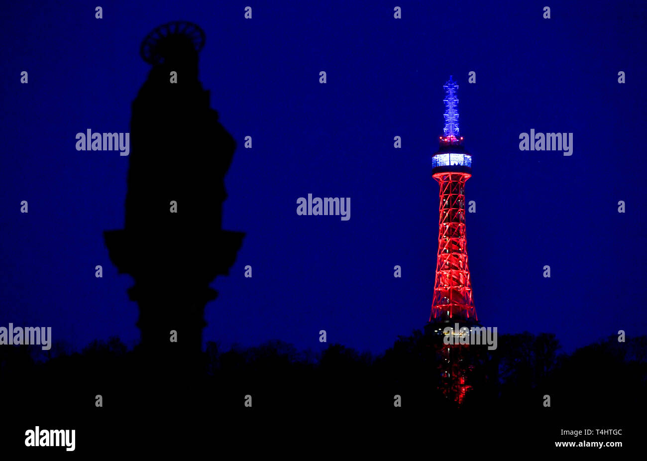 Prague, Czech Republic. 16th Apr, 2019. The lookout tower on Petrin hill in Prague centre was lit in the French national colours, red, blue and white, today, on Tuesday, April 16, 2019, in memory of the yesterday's fire-damaged Notre-Dame Cathedral in Paris. Credit: Vit Simanek/CTK Photo/Alamy Live News Stock Photo