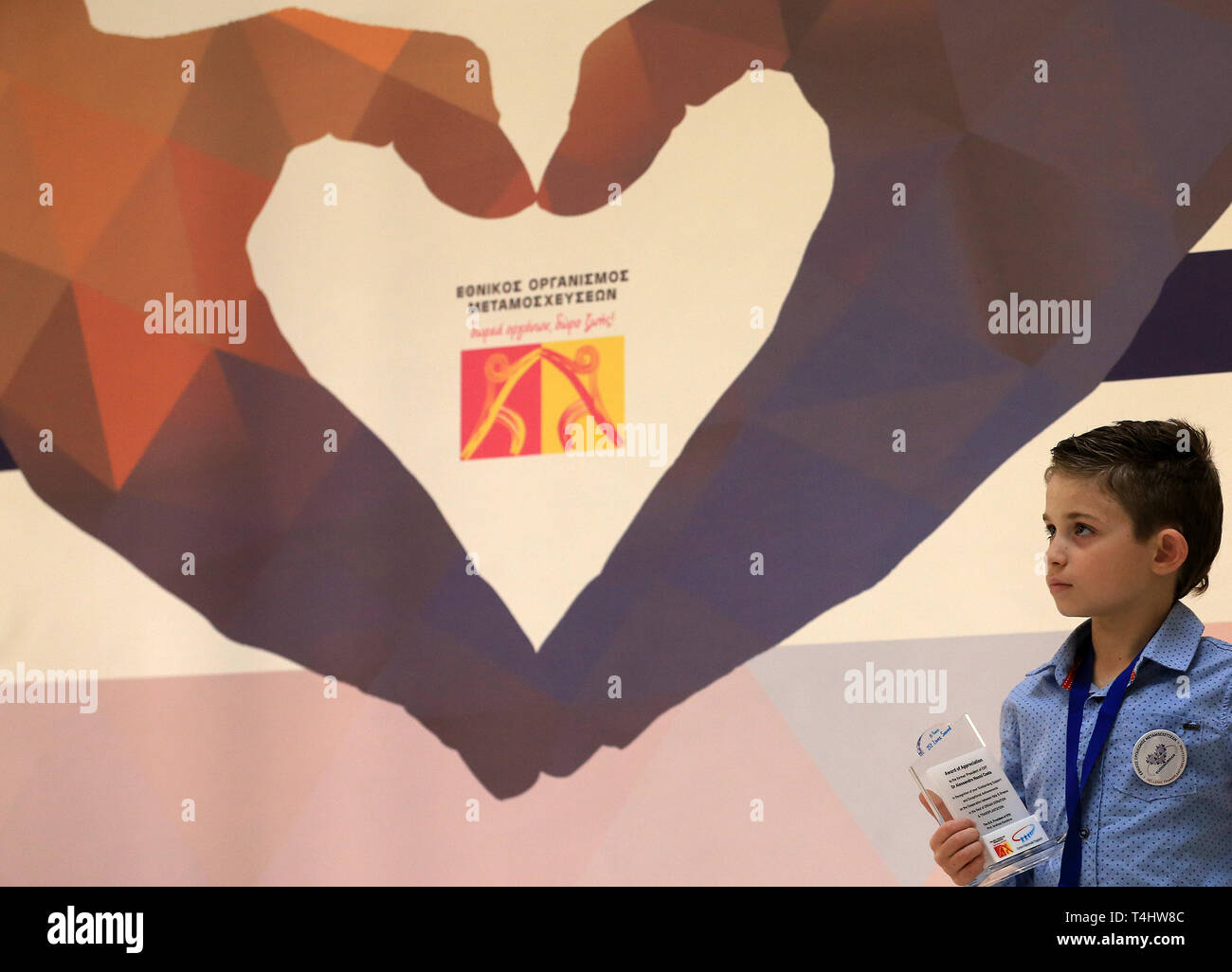 Athens, Greece. 15th Apr, 2019. A boy attends the Hellenic Transplant Organization's social awareness event in Athens, Greece, on April 15, 2019. Greece aims to double the rate of human organ donations for transplants within the next two years, the President of the Hellenic Transplant Organization (EOM), Andreas Karabinis, told Xinhua on Monday. Credit: Marios Lolos/Xinhua/Alamy Live News - Stock Image