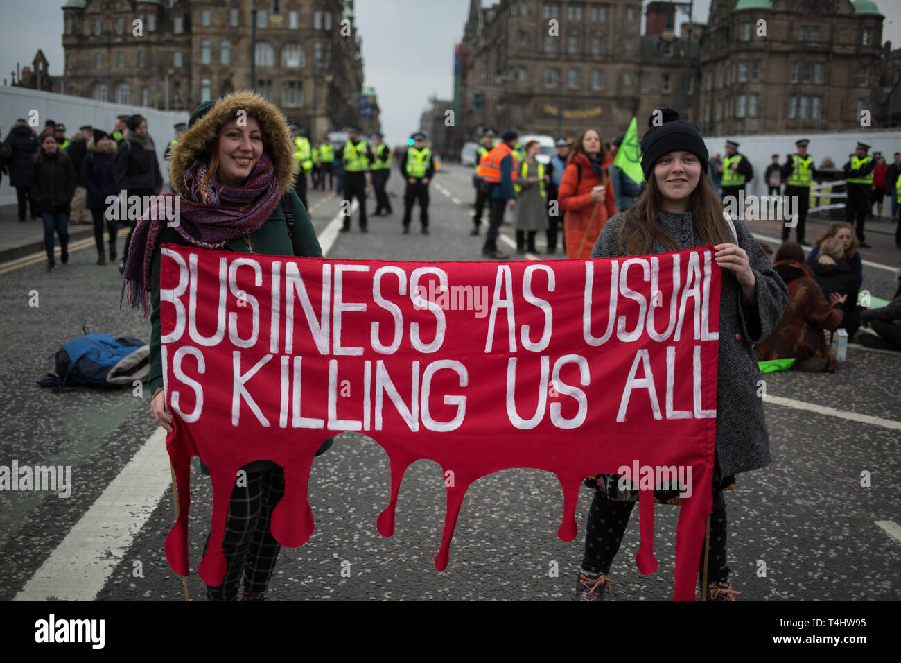 Edinburgh, Scotland, 16th April 2019. Extinction Rebellion (Scotland) climate protestors shut North Bridge to traffic during an 'International Day of Rebellion', asking for the government to declare a climate emergency, in Edinburgh, Scotland, on 16 April 2019. Credit: Jeremy Sutton-Hibbert/Alamy Live News - Stock Image