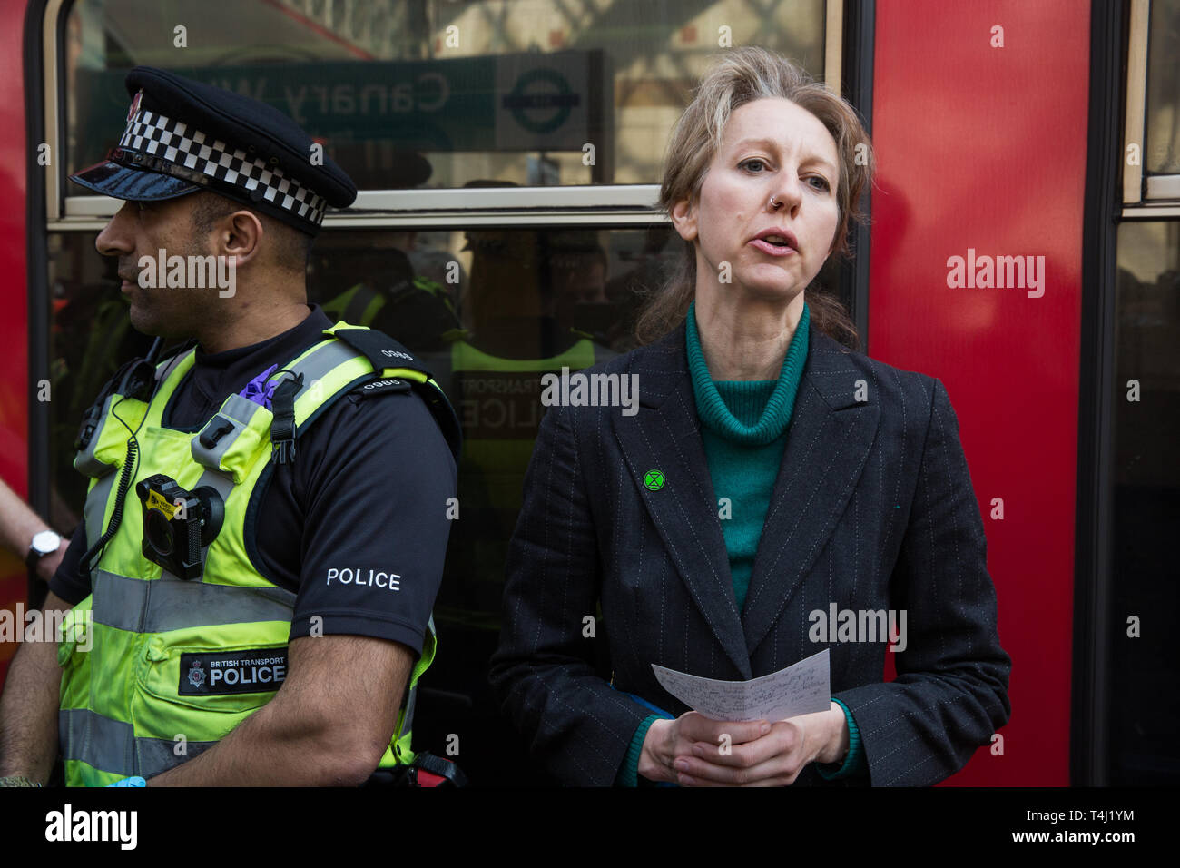 London, UK. 17th April 2019. Dr Gail Bradbrook of Extinction Rebellion addresses journalists after climate change activists from Extinction Rebellion glued themselves to a DLR train at Canary Wharf station on the third day of International Rebellion activities to call on the British government to take urgent action to combat climate change. Credit: Mark Kerrison/Alamy Live News Stock Photo